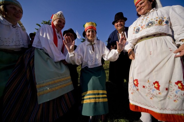 People wearing folk costumes