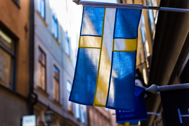 Swedish flag in between buildings